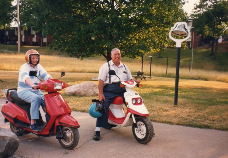 Grandpa & Grandma B. enjoying a scooter ride.