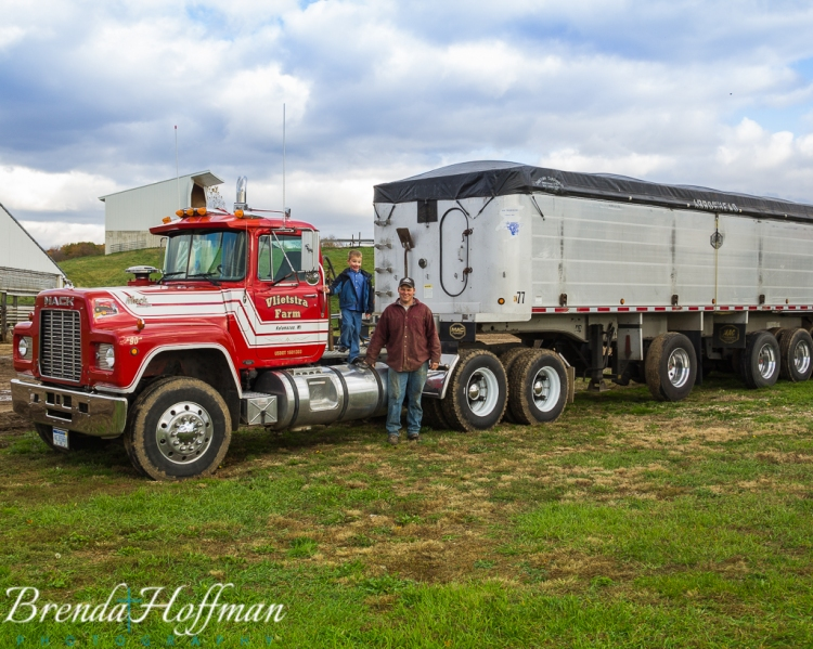 Fred and my son with one of the Mack trucks.  Photo credit:  Brenda Hoffman Photography